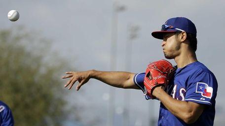 Texas Rangers pitcher Yu Darvish throws during spring