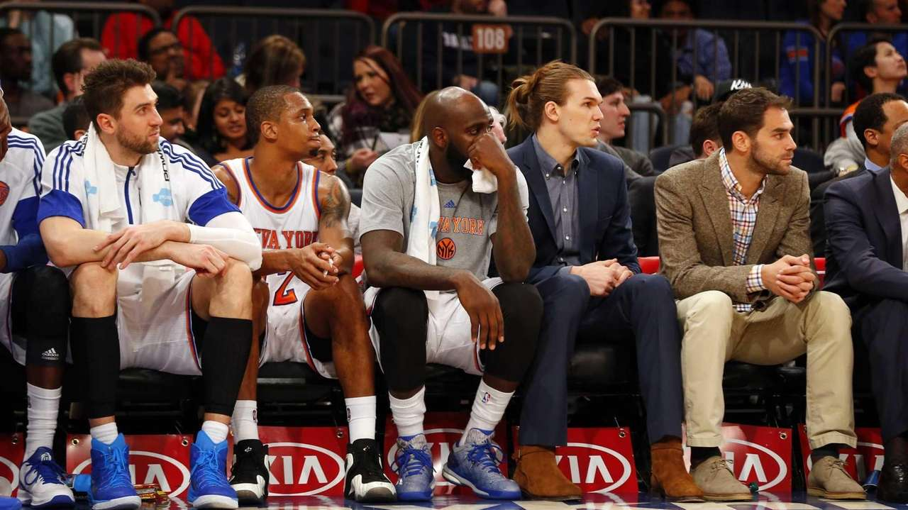 The New York Knicks look on late in