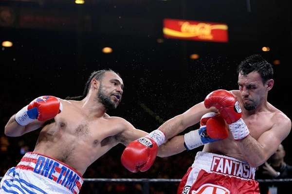 Keith Thurman, left, and Robert Guerrero fight during