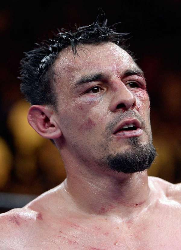 Robert Guerrero reacts after fighting Keith Thurman during
