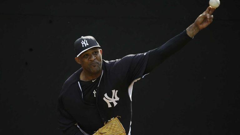 Yankees starting pitcher CC Sabathia throws in the