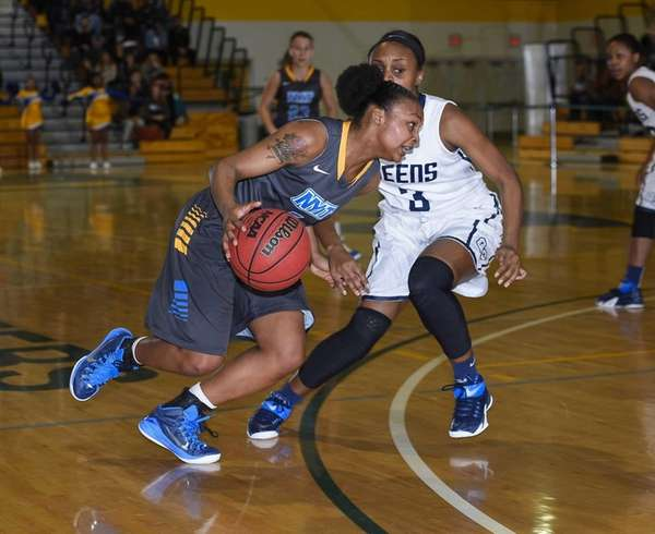 NYIT's Shanice Allen drives on Queens' Amber Harrison
