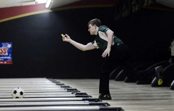 Sachem East's Nick Caruana bowls for Section 11