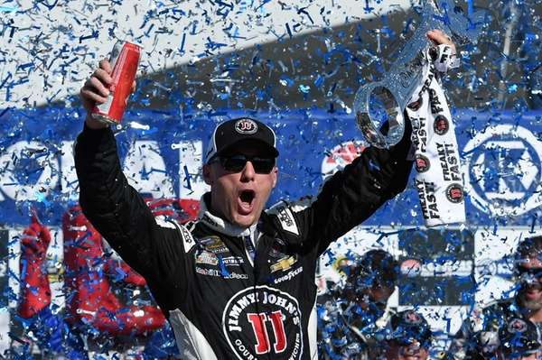 Kevin Harvick celebrates in Victory Lane after winning