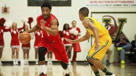 Stony Brook's Deshaun Thrower, left, moves downcourt during
