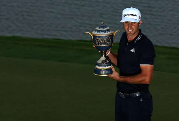 Dustin Johnson of the United States poses with