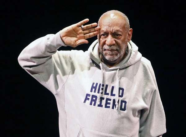 Bill Cosby greets the crowd as he begins