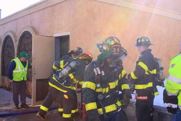 Huntington Manor firefighters investigate a fire at the