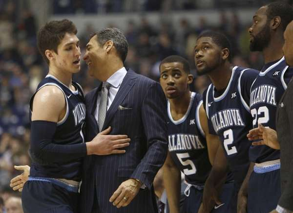 Villanova head coach Jay Wright, second from left,