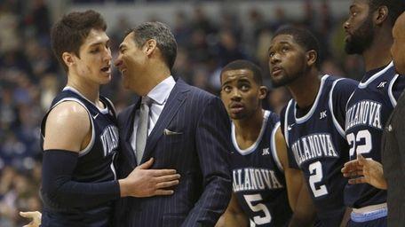 Villanova head coach Jay Wright, second from left,