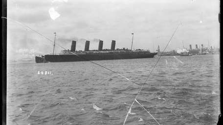A vintage photo of the Lusitania leaving New