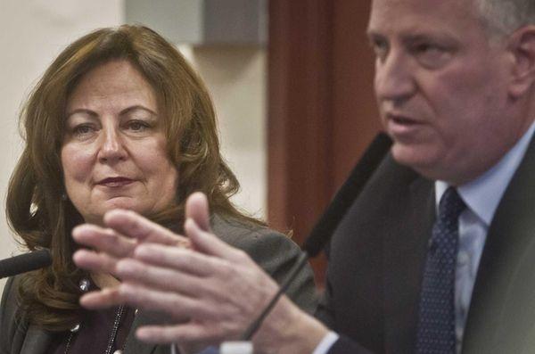 Aimee Horowitz, left, listens as Mayor Bill de