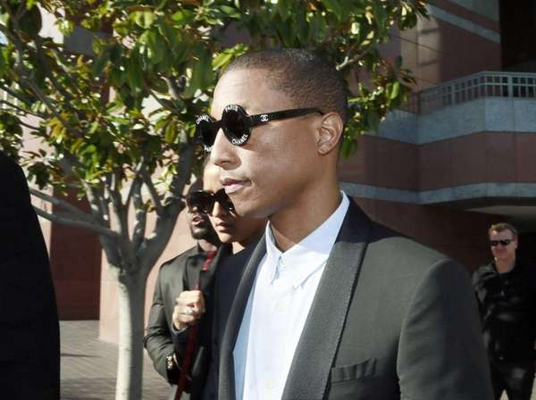Pharrell Williams leaves Los Angeles Federal Court after