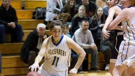 Lindsey Ehrhardt of Kellenberg drives to the basket