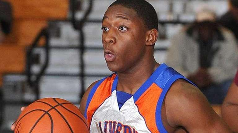 Malverne's Chris Hackett, left, races downcourt during the