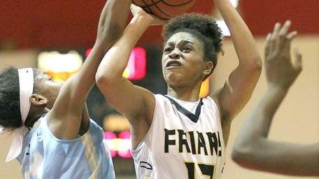 St. Anthony's Etalyia Vogt runs into traffic during