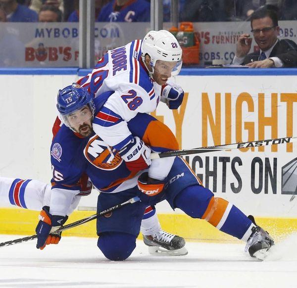 Cal Clutterbuck of the New York Islanders battles