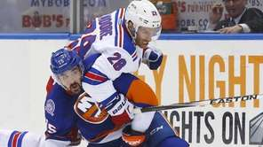 Cal Clutterbuck of the New York Islanders battles