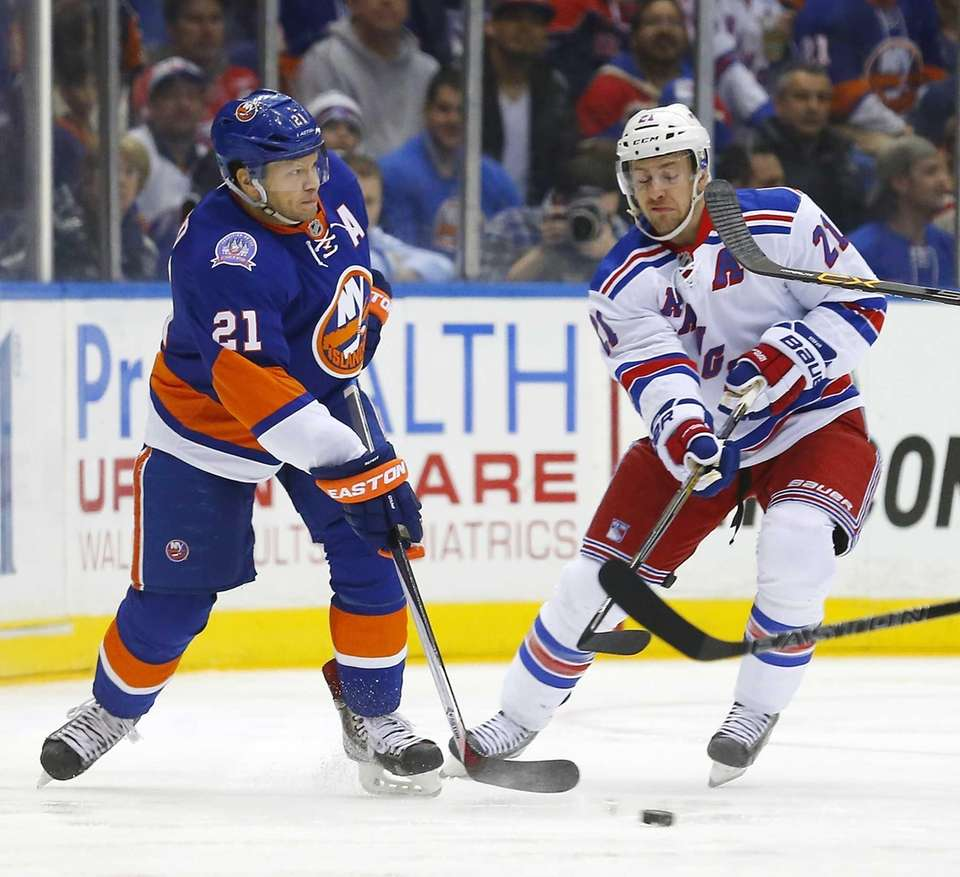 Kyle Okposo of the New York Islanders plays