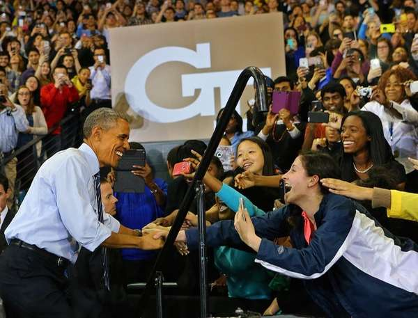 Students reach out for President Barack Obama as