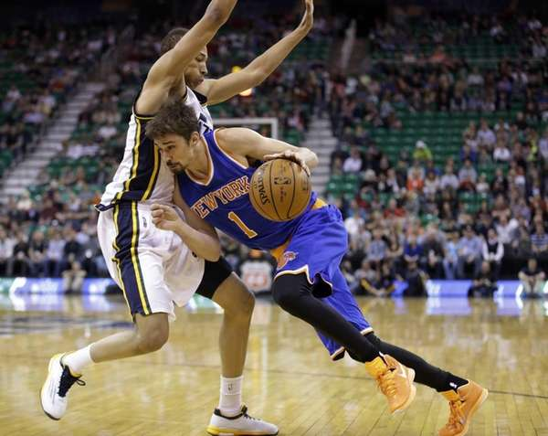 New York Knicks guard Alexey Shved drives around