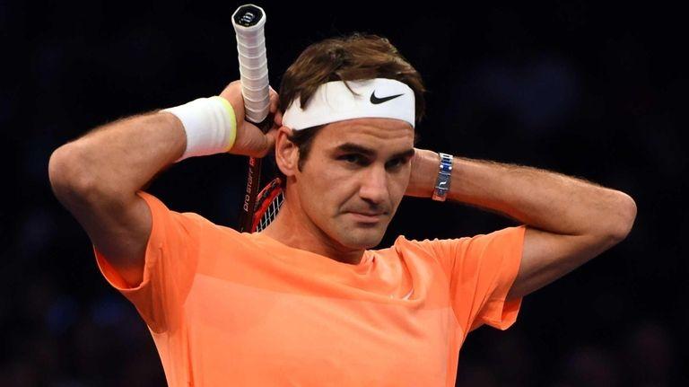 Roger Federer of Switzerland pauses on court against