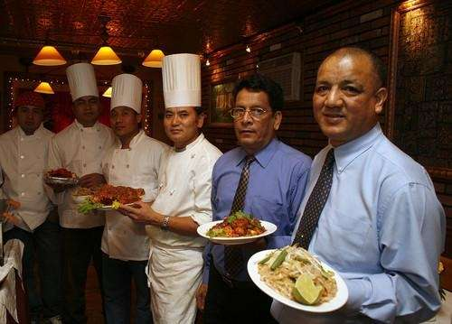 Owner Kumar Chhetri, right, and staff at Chilli