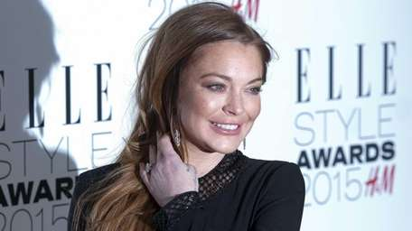 Lindsay Lohan arrives at the Elle Style Awards