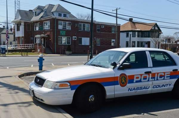 A police car sits across the street from