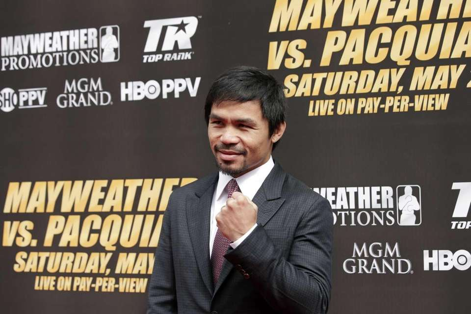Manny Pacquiao, of the Philippines, poses for photos