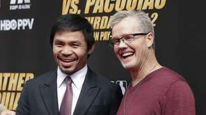 Boxer Manny Pacquiao, left, of the Philippines, and