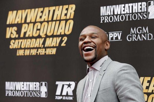 Boxer Floyd Mayweather Jr. arrives for a news