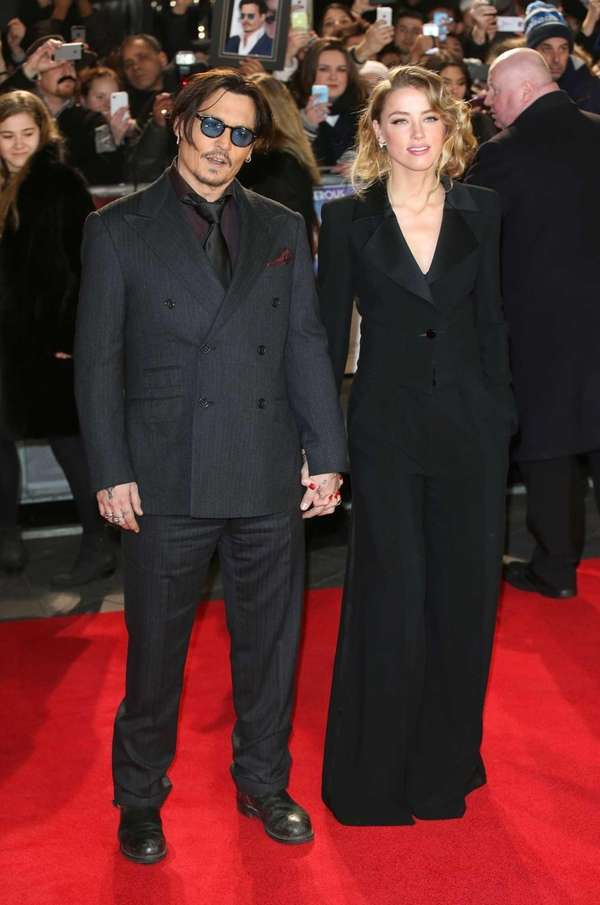 Actor Johnny Depp and Amber Heard attend the