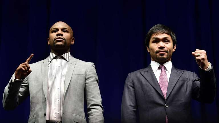 Floyd Mayweather, left, and Manny Pacquiao pose during