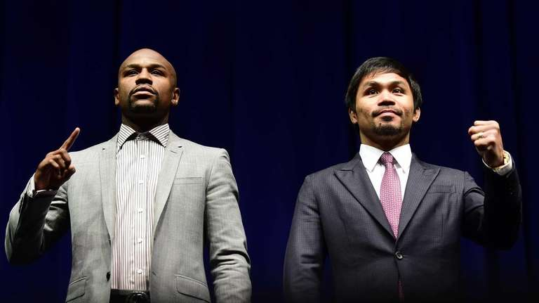 Boxers Manny Pacquiao (R) from the Philippines and