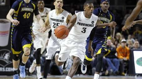 Providence guard Kris Dunn dribbles the ball up