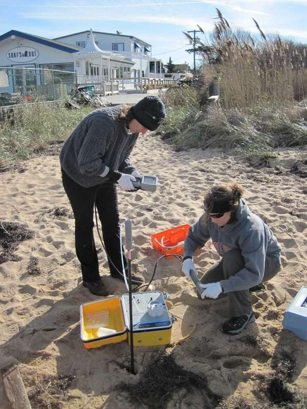 Workers in Kismet, Fire Island sample groundwater for