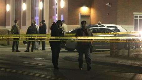 Police gather outside the Ferguson Police Department Thursday,