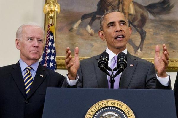 Vice President Joe Biden listens as President Barack