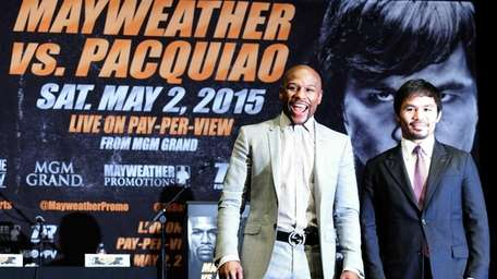Floyd Mayweather Jr., left, and Manny Pacquiao pose
