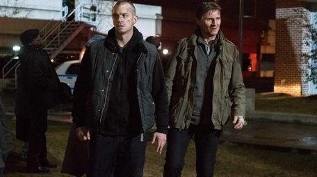 Joel Kinnaman and Liam Neeson appear in a