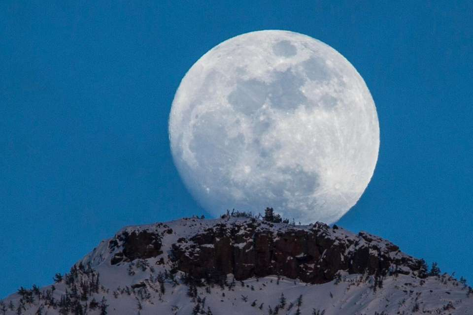 A spectacular moonrise over Yellowstone National Park.