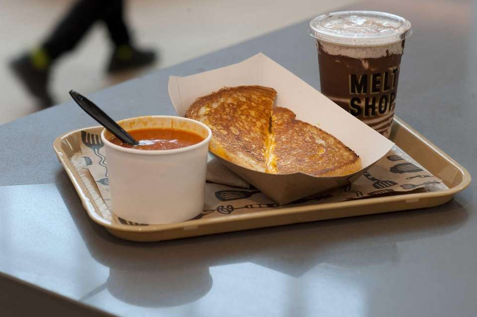 A classic grilled cheese sandwich with tomato soup