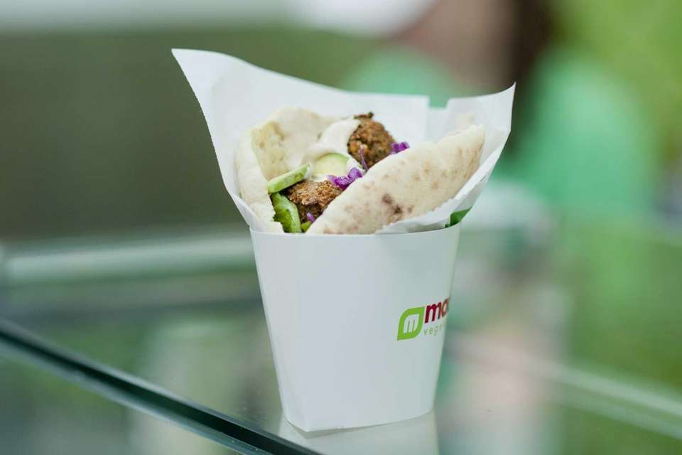 A falafel sandwich is served at Maoz Vegetarian,