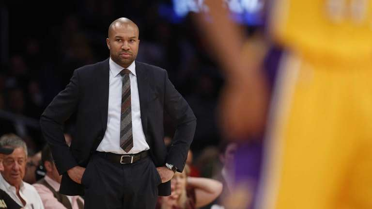 New York Knicks coach Derek Fisher watches his