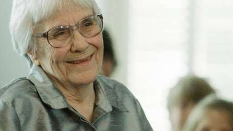 Author Harper Lee smiles during a ceremony honoring