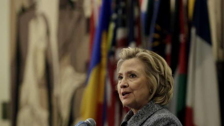 Hillary Rodham Clinton answers questions at a news