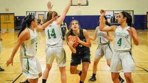 Carle Place's Kacey Burden, center, drives during the