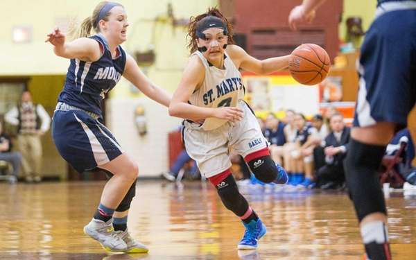 St. Mary's Mei-Lyn Bautista drives on Archbishop Molloy