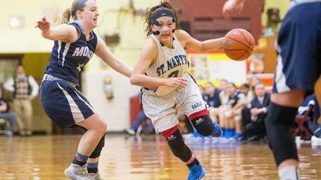 St. Mary's Mei-Lyn Bautista drives on Archbishop Molloy